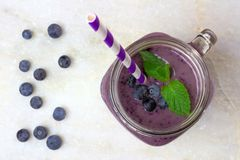 Blueberry smoothie in jar on white marble Stock Photo