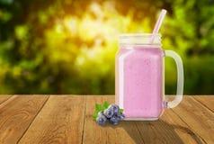 Blueberry smoothie in mason jar stock photo