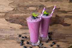 Blueberry smoothie purple colorful fruit juice milkshake blend beverage healthy high protein the taste yummy In glass,drink episod. E morning on a wooden royalty free stock images