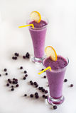 Blueberry smoothie on a white background Royalty Free Stock Images