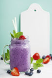 Blueberry smoothie and White ceramic serving board Royalty Free Stock Images