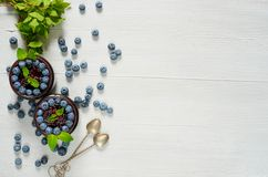 Blueberry smoothies with fresh mint leaves on the gray background. Summer detox superfoods breakfast or healthy dessert. Top view with copy space for text stock image