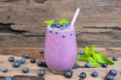 Blueberry smoothies juice and blueberry fruit black drink delicious in a glass morning drink on a wooden background. stock photography