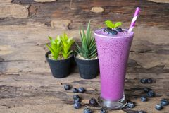 Blueberry smoothies purple colorful fruit juice milkshake. Blueberry smoothies purple colorful fruit juice milkshake blend beverage healthy high protein the royalty free stock images