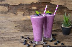 Blueberry smoothies purple colorful fruit juice milkshake. Blueberry smoothies purple colorful fruit juice milkshake blend beverage healthy high protein the stock photo