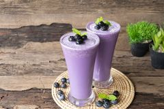 Blueberry smoothies purple colorful fruit juice milkshake . Blueberry smoothies purple colorful fruit juice milkshake blend beverage healthy high protein the royalty free stock photo