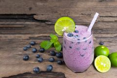 Blueberry smoothies purple colorful fruit Juice mix lemon milkshake . Blueberry smoothies purple colorful fruit Juice mix lemon milkshake blend beverage healthy stock photos