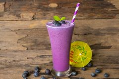 Blueberry smoothiesl fruit juice milkshake blend beverage healthy high protein the taste yummy In glass drink episode. Blueberry smoothie purple colorful fruit stock photos
