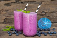 Blueberry smoothiesl fruit juice milkshake blend beverage healthy high protein the taste yummy In glass drink episode. Blueberry smoothie purple colorful fruit royalty free stock photos