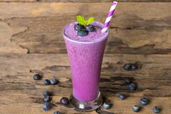 Blueberry smoothiesl fruit juice milkshake blend beverage healthy high protein the taste yummy In glass drink episode. Blueberry smoothie purple colorful fruit royalty free stock photography