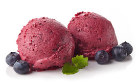 Blueberry sorbet. Two blueberry ice cream sorbet balls isolated on white background Stock Photo
