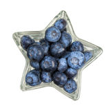 Blueberry in a star shaped bowl, isolated on white background Royalty Free Stock Image