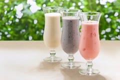 Blueberry, Strawberry and Banana milk shake Royalty Free Stock Photo