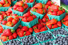 Blueberry and strawberry baskets on fruit stand Royalty Free Stock Images