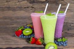 Blueberry strawberry and kiwi smoothies colorful fruit juice milkshake. Blueberry strawberry and kiwi smoothies colorful fruit juice milkshake blend beverage stock photo
