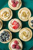 Berry pies on wooden table Royalty Free Stock Image