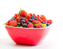 Blueberry, strawberry, raspberry, black and red currant. In red bowl Stock Photos