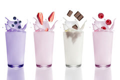 Blueberry, strawberry, raspberry and chocolate milk shakes stock images