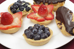 Blueberry and strawberry tarts Royalty Free Stock Images