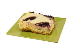 Blueberry swiirl cheesecake on white Stock Image