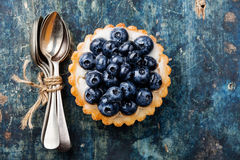 Blueberry tart and bunch of teaspoons Stock Photography