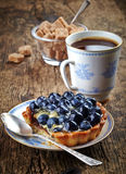 Blueberry tart and coffee Royalty Free Stock Photos