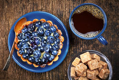 Blueberry tart and coffee Stock Images