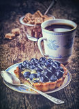 Blueberry tart and coffee Stock Photos