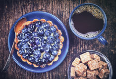 Blueberry tart and coffee Stock Photo
