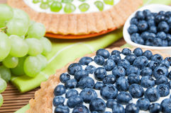 Blueberry tart and grape tart Royalty Free Stock Image