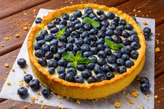 Blueberry Tart on vintage wooden background Stock Photo