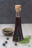 Blueberry and thyme vinegar with fresh fruits Stock Photography