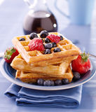 Blueberry waffles with strawberries royalty free stock photo