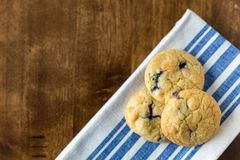 Blueberry and White Chocolate Chip Cookies with fresh blueberries royalty free stock photos