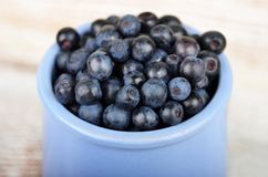 Blueberry on wooden background Royalty Free Stock Images