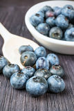 Blueberry on wooden board Stock Photos