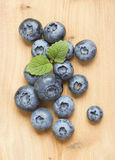 Blueberry on a wooden board. Fresh berries of blueberry are picked for decoration of cake. This healthy food because are useful to blood system Stock Photos
