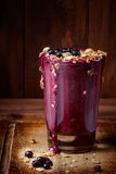 Blueberry yoghurt drink. Berry cocktail with blueberries and yogurt and granola crumbly . nutritious , easy , healthy beverage for modern people . fashionable royalty free stock photography