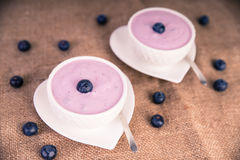 Blueberry yoghurt on heart shaped plate. Picture of blueberry yoghurt in bowls royalty free stock photos