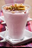 Blueberry yogurt. And muesli with dried fruit stock images