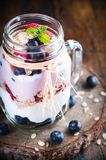 Combined fruit and yogurt in glass with rustic background Royalty Free Stock Image