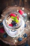 Combined fruit and yogurt in glass with rustic background Stock Photography
