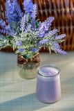Blueberry yogurt in glass jars on wooden table in summertime. Homemade milk sweet yogurt with bilberry. royalty free stock image