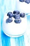 Blueberry and yogurt in high key. Tasty fresh blueberry yoghurt shake dessert on table royalty free stock photo