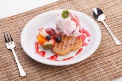 Blueberry yogurt ice cream serve with waffle Stock Photos