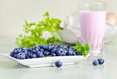 Blueberry yogurt and ripe berries Stock Photography