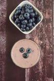 Blueberry yogurt smoothie. On wooden background Stock Image