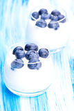 Blueberry and yogurt two glasses. Tasty fresh blueberry yoghurt shake dessert on table stock photos