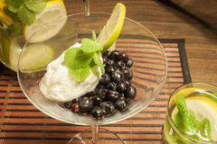 Blueberrys and quark with mint. Standing in a glass on a tablet Stock Photography