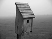 Bluebird house in countryside setting Royalty Free Stock Photography